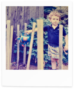 Retro polaroid photograph of a child in a garden